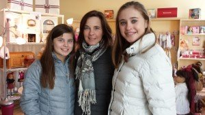 Mother and daughters donate dolls