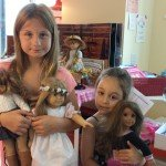 Sisters with dolls