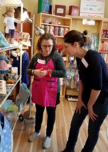 Coach Jennifer working with a trainee, assessing a merchandise display