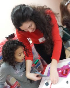 Cristina helping a little girl