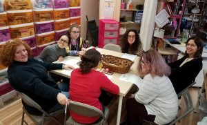 Lesli at table with trainees