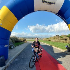 Marjorie at finish of Bike to the Beach