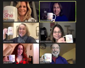 board members showing mugs